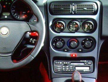 foto Autoradio originale Alfa Romeo (Clarion) in blocco su GTV 916 - 1